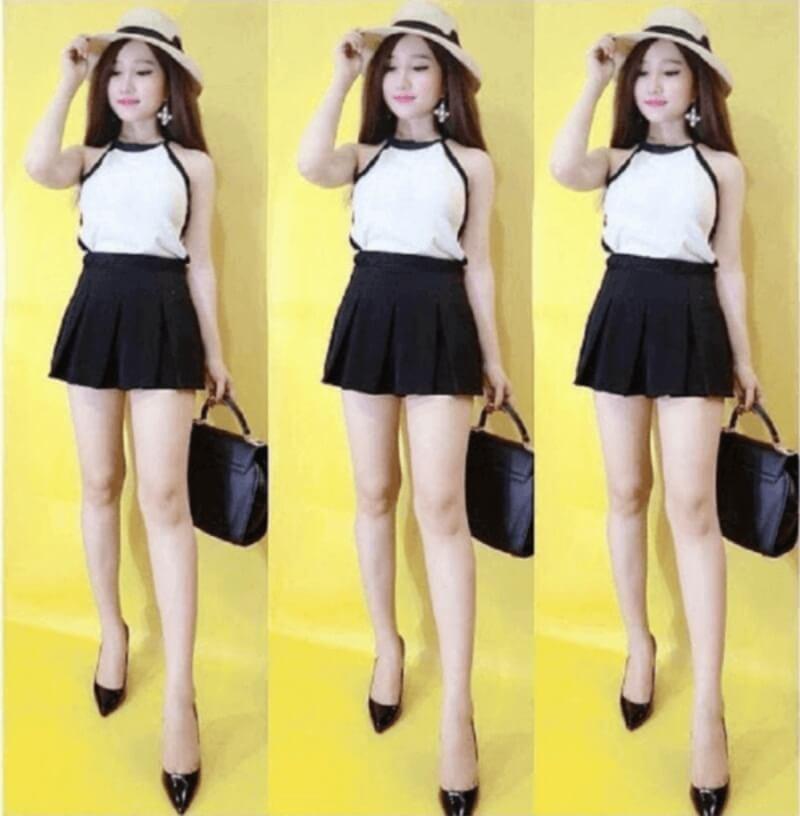 Áo yếm phối chân váy xòe đen giúp dáng thon gọn và cao ráo hơn
